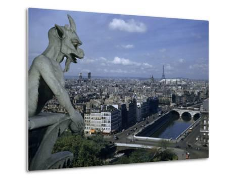 Gargoyle on Notre Dame Looks Down on a Densely Packed Cityscape-Justin Locke-Metal Print