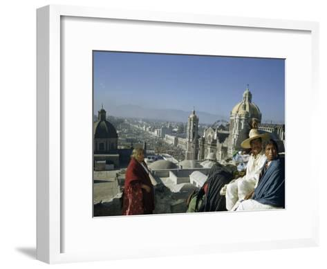 Four People Sit on Rooftop Overlooking Our Lady of Guadalupe Church-Justin Locke-Framed Art Print