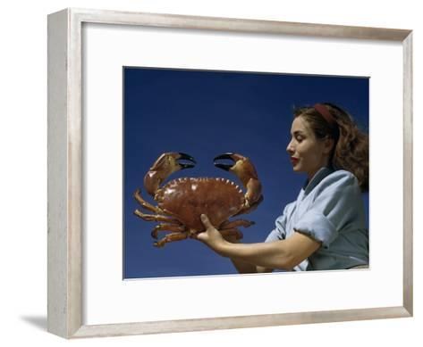 Woman Holds a Crab Caught in the Bay of Biscay-Luis Marden-Framed Art Print