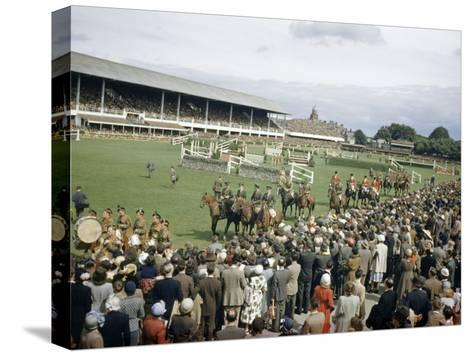 Jumping Teams Pass in Review at the Dublin Horse Show-Maynard Owen Williams-Stretched Canvas Print