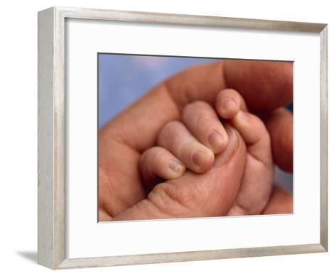 Adult Holds a Baby's Hand-Michael Melford-Framed Art Print