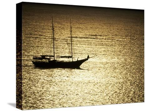 Silhouette of a Double Masted Sailboat on the Water-Michael Melford-Stretched Canvas Print
