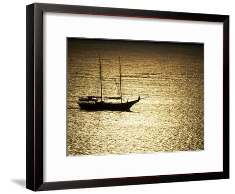 Silhouette of a Double Masted Sailboat on the Water-Michael Melford-Framed Art Print