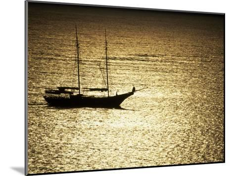 Silhouette of a Double Masted Sailboat on the Water-Michael Melford-Mounted Photographic Print