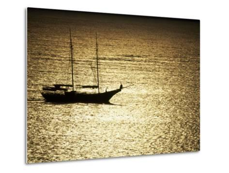 Silhouette of a Double Masted Sailboat on the Water-Michael Melford-Metal Print