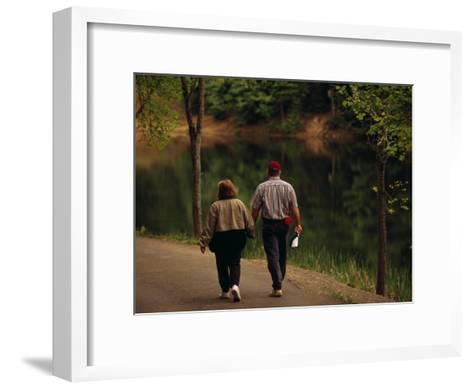Couple Walking by the Water Along a Park Road-Raymond Gehman-Framed Art Print
