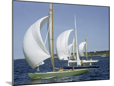 Sailboats Cross a Race Course Starting Line with Wind-Filled Sails-Robert Sisson-Mounted Photographic Print