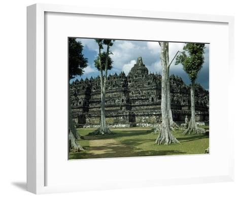 Woman Stands in Shade Beside Tall Trees Near Borobudur Temple-W^ Robert Moore-Framed Art Print