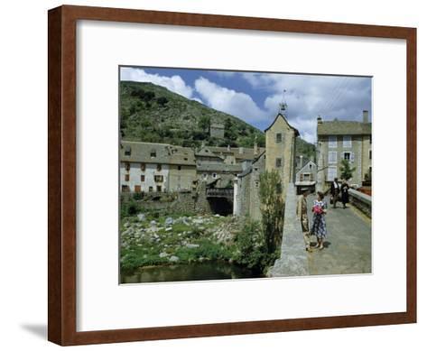 People in Riverside Village Walk across an Old Bridge-Walter Meayers Edwards-Framed Art Print