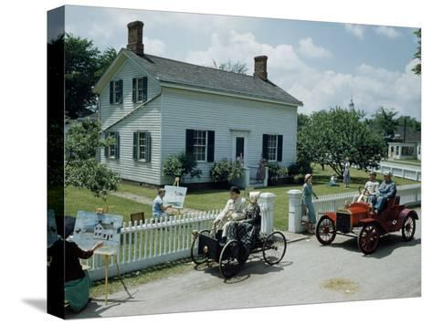 People in Costume Park Antique Ford Cars Near Henry Ford's Birthplace-Andrew Brown-Stretched Canvas Print