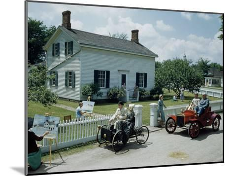 People in Costume Park Antique Ford Cars Near Henry Ford's Birthplace-Andrew Brown-Mounted Photographic Print