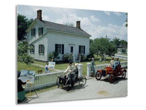 People in Costume Park Antique Ford Cars Near Henry Ford's Birthplace-Andrew Brown-Metal Print