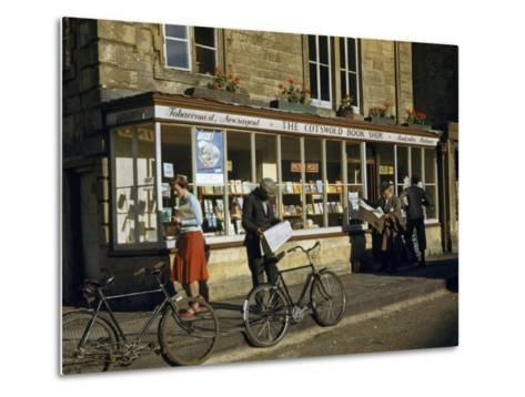 Villagers Read Newspapers Near Bicycles Outside a Book Shop-Melville Grosvenor-Metal Print
