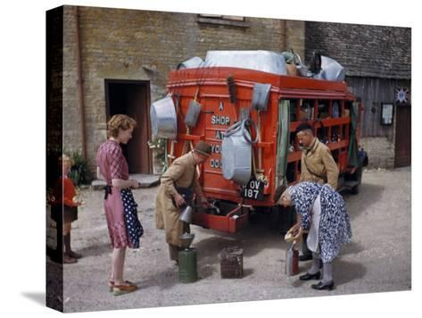 Villagers Buy Oil from Traveling Salesman by His Truck of Wares-Melville Grosvenor-Stretched Canvas Print