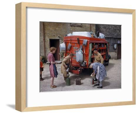 Villagers Buy Oil from Traveling Salesman by His Truck of Wares-Melville Grosvenor-Framed Art Print
