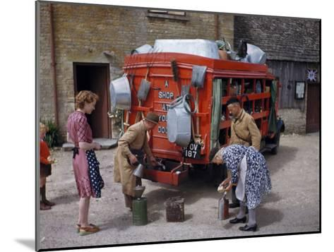 Villagers Buy Oil from Traveling Salesman by His Truck of Wares-Melville Grosvenor-Mounted Photographic Print