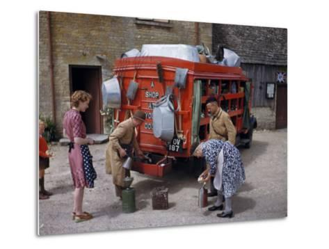 Villagers Buy Oil from Traveling Salesman by His Truck of Wares-Melville Grosvenor-Metal Print