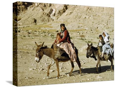 Kashgai Family on Baggage-Laden Burros Migrates to Mountain Pastures-Joseph Baylor Roberts-Stretched Canvas Print