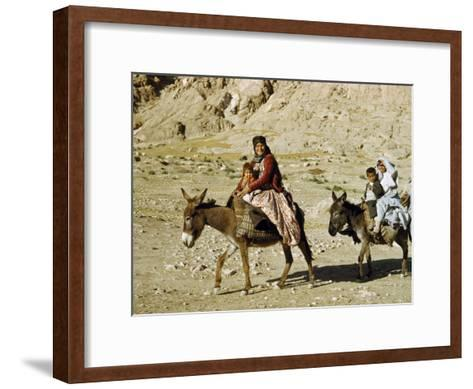 Kashgai Family on Baggage-Laden Burros Migrates to Mountain Pastures-Joseph Baylor Roberts-Framed Art Print