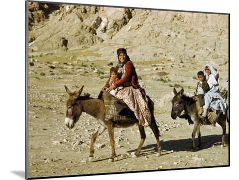 Kashgai Family on Baggage-Laden Burros Migrates to Mountain Pastures-Joseph Baylor Roberts-Mounted Photographic Print
