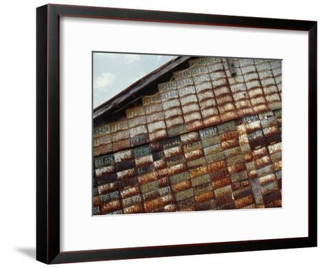 Side of a Building Adorned with Old License Plates-Raymond Gehman-Framed Art Print