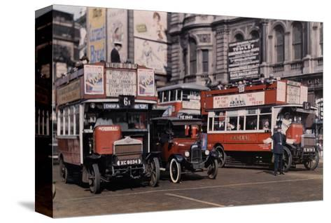 Policeman Directs Buses in the Intersection of Trafalgar Square-Clifton R^ Adams-Stretched Canvas Print
