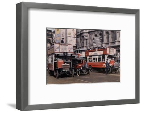 Policeman Directs Buses in the Intersection of Trafalgar Square-Clifton R^ Adams-Framed Art Print