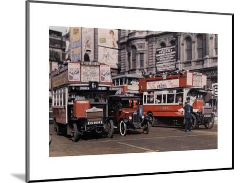 Policeman Directs Buses in the Intersection of Trafalgar Square-Clifton R^ Adams-Mounted Photographic Print