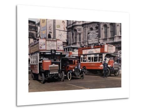 Policeman Directs Buses in the Intersection of Trafalgar Square-Clifton R^ Adams-Metal Print