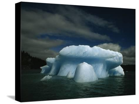 Melting Iceberg under a Cloud Filled Sky-Paul Chesley-Stretched Canvas Print