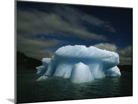 Melting Iceberg under a Cloud Filled Sky-Paul Chesley-Mounted Photographic Print