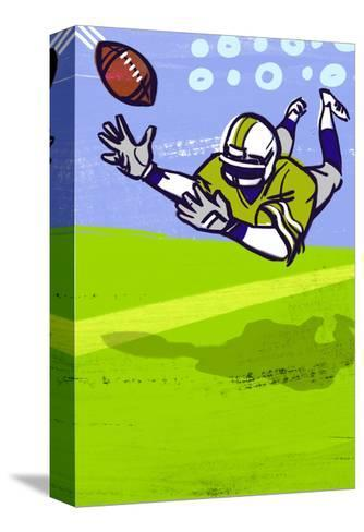 Diving to Catch Football--Stretched Canvas Print