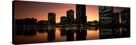 Buildings Lit Up at Dusk, Oakland, Alameda County, California, USA--Stretched Canvas Print