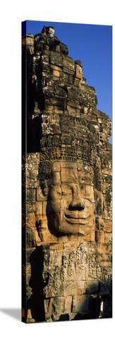 Face Carved on Rocks in a Temple, Bayon Temple, Angkor, Cambodia--Stretched Canvas Print