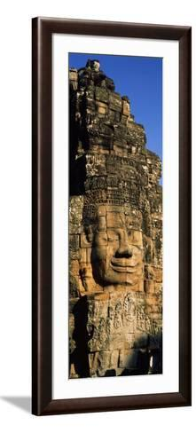 Face Carved on Rocks in a Temple, Bayon Temple, Angkor, Cambodia--Framed Art Print