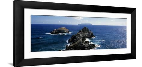 Rock Formations in the Sea with an Island in the Background, Desirade Island, Pointe Des Chateaux, --Framed Art Print