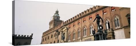 Statue in Front of Palace, Fountain of Neptune, Palazzo D'Accursio, Piazza Maggiore, Bologna, Italy--Stretched Canvas Print