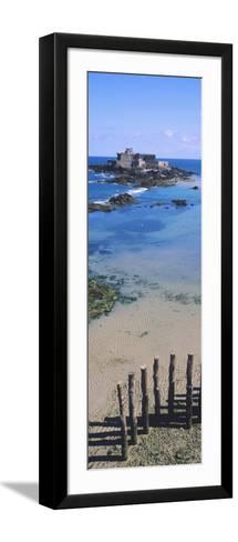 View of Wooden Posts on the Beach with a Fort in the Background, St-Malo, Brittany, France--Framed Art Print