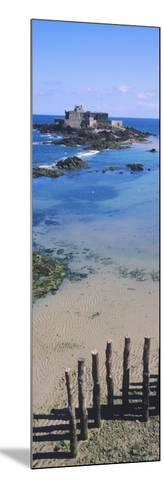 View of Wooden Posts on the Beach with a Fort in the Background, St-Malo, Brittany, France--Mounted Photographic Print