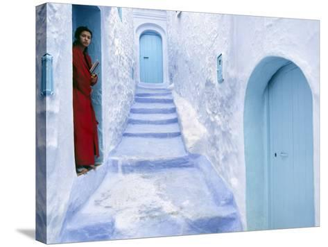 Local Woman Steps Out into Whitewashed Streets of Rif Mountains Town of Chefchaouen, Morocco-Andrew Watson-Stretched Canvas Print