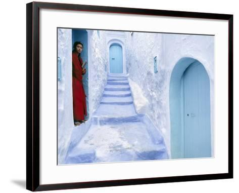 Local Woman Steps Out into Whitewashed Streets of Rif Mountains Town of Chefchaouen, Morocco-Andrew Watson-Framed Art Print
