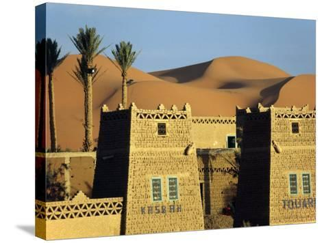 Merzouga a Desert Kasbah Backing onto Giant Sand Dunes of Erg Chebbi in Eastern Morocco, Morocco-Andrew Watson-Stretched Canvas Print
