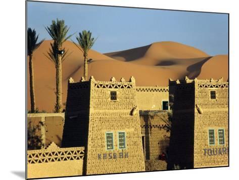 Merzouga a Desert Kasbah Backing onto Giant Sand Dunes of Erg Chebbi in Eastern Morocco, Morocco-Andrew Watson-Mounted Photographic Print