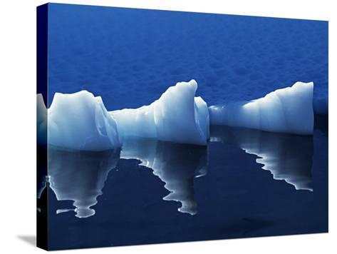 Antarctic Peninsula, Paradise Harbour, Icebergs Colours and Shapes at the Chilean Base in Paradise -Mark Hannaford-Stretched Canvas Print