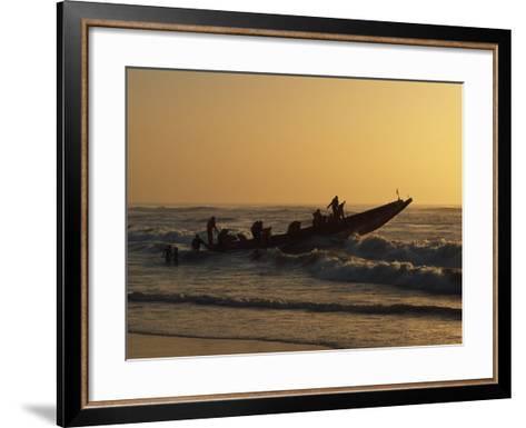 Fishermen Launch their Boat into the Atlantic Ocean at Sunset-Amar Grover-Framed Art Print