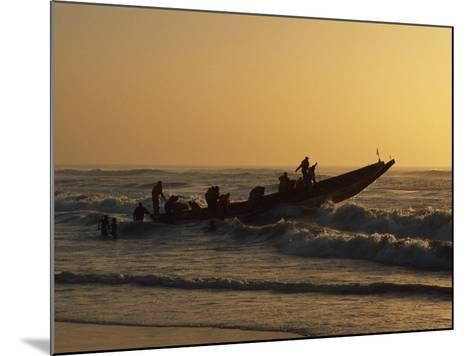 Fishermen Launch their Boat into the Atlantic Ocean at Sunset-Amar Grover-Mounted Photographic Print