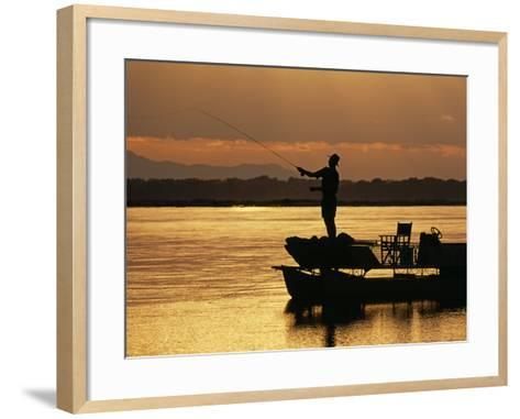 Lower Zambezi National Park, Fly Fishing for Tiger Fish from a Barge on the Zambezi River at Dawn, -John Warburton-lee-Framed Art Print