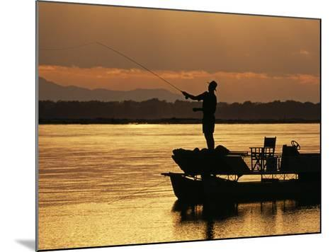 Lower Zambezi National Park, Fly Fishing for Tiger Fish from a Barge on the Zambezi River at Dawn, -John Warburton-lee-Mounted Photographic Print