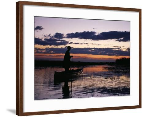 Zambia Game Scout Poling Mokorro Along Lukulu River at Sunset-John Warburton-lee-Framed Art Print
