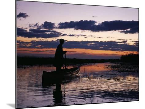 Zambia Game Scout Poling Mokorro Along Lukulu River at Sunset-John Warburton-lee-Mounted Photographic Print